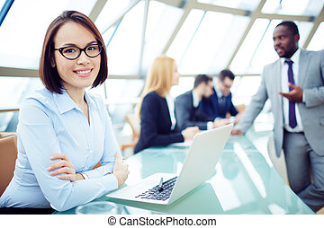 Friendly employer - Young smiling woman at meeting