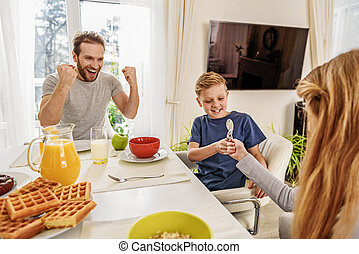 Friendly family having fun before breakfast