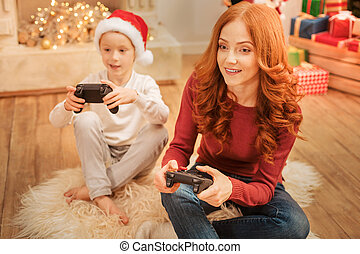 Friendly family playing video games together