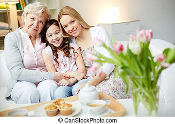Friendly family - Portrait of happy little girl, her mother...