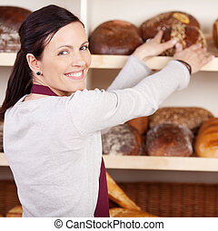 Friendly female bakery employee