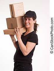 Friendly female courier with a pile of parcels