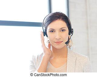 friendly female helpline operator - bright picture of...