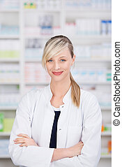 Friendly female pharmacist with crossed arms