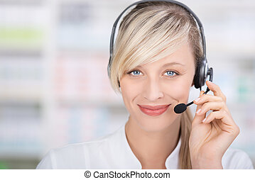 Friendly female pharmacist with headsets