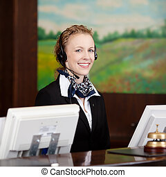 Friendly female receptionist wearing a headset