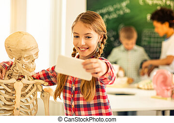 Friendly girl embracing her new artificial skeleton