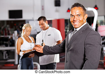 friendly gym manager welcome customer