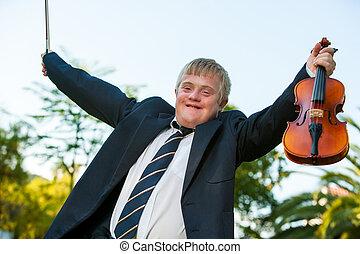 Friendly handicapped boy raising violin outdoors. - Happy ...