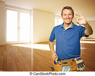 friendly handyman in new house - smiling man and 3d indoor...