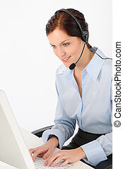 Friendly help desk woman typing computer