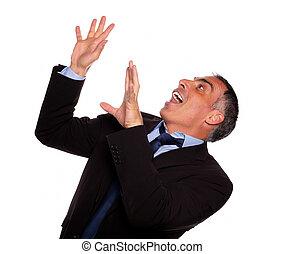 Friendly hispanic businessman screaming