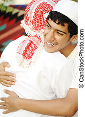 Friendly hug, two arabic guys