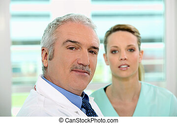 Friendly looking doctor and nurse