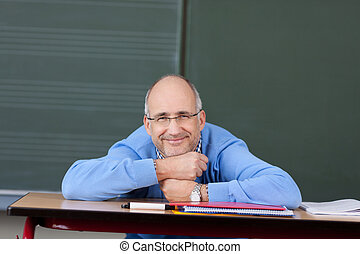 Friendly male teacher relaxing
