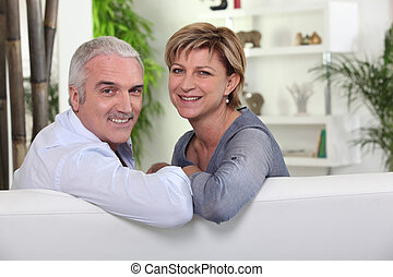 friendly mature couple in a lounge