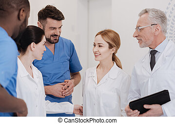 Friendly medical team meeting new colleague in the clinic