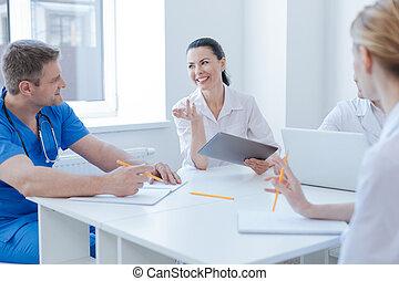 Friendly medics enjoying conversation at the clinic