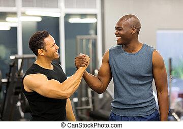 men handshaking in gym