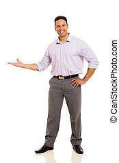 middle aged businessman doing welcome gesture