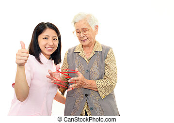 Friendly nurse with elderly woman