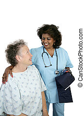 Friendly Patient Care - A friendly nurse caring for an...
