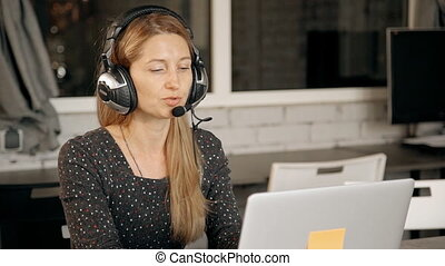 Friendly pleasant telemarketing operator consulting customer about online shop.