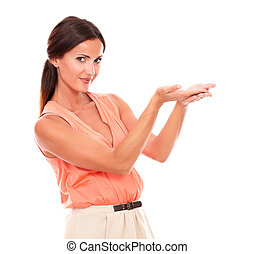 Friendly pretty woman holding palms up