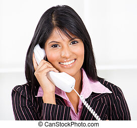friendly receptionist on the phone
