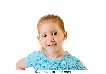 Friendly redhead elementary age girl in blue top