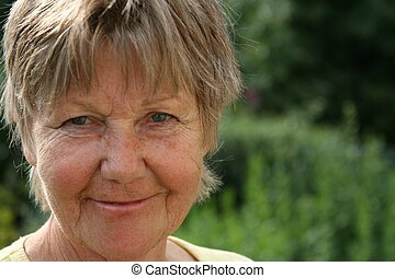 portrait of a smiling retiree, female