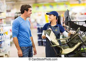 saleswoman selling camping chair
