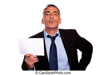 Friendly senior businessman showing a while card