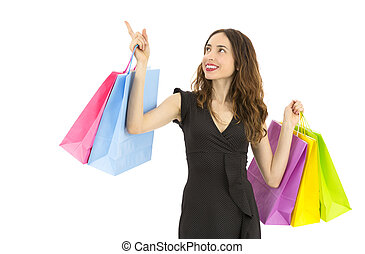 Friendly shopping woman showing copy space