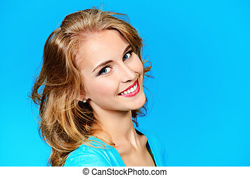 friendly smile - Friendly smiling young woman in casual...