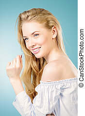 friendly smile - Cute young woman with beautiful blonde hair...