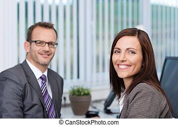 Friendly smiling businesswoman - Friendly confident...