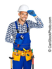 Friendly smiling construction worker with wrench saluting...