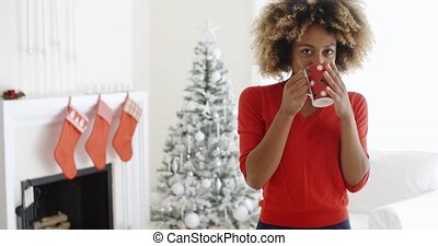Friendly smiling young woman celebrating Christmas