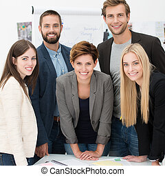 Friendly successful business team of multiethnic young...