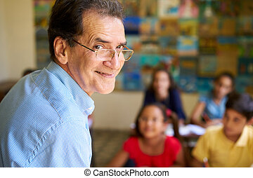 Friendly Teacher In Class Happy Professor Smiling At Camera