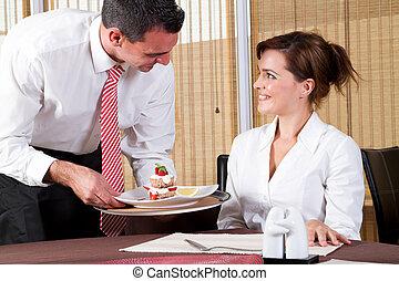 friendly waiter and customer - friendly male waiter brings...