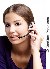 friendly woman - a young woman with brown hair and headset