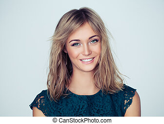 Friendly woman student smiling on white background