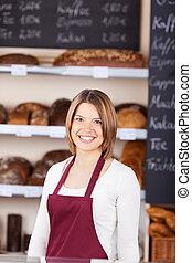Friendly worker in a bakery