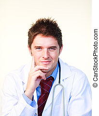 Friendly young doctor looking at the camera