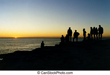 A group of friends watching sunrise