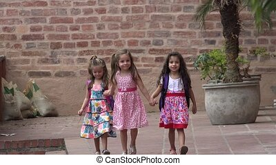 Friends And Little Girls Walking