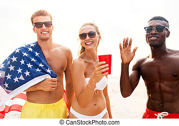 friends at american independence day beach party