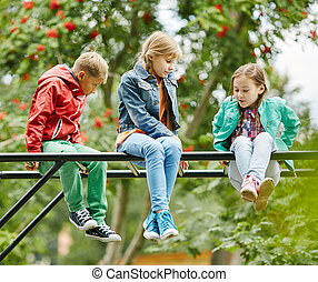 Friends at leisure - Friendly kids spending leisure outdoors